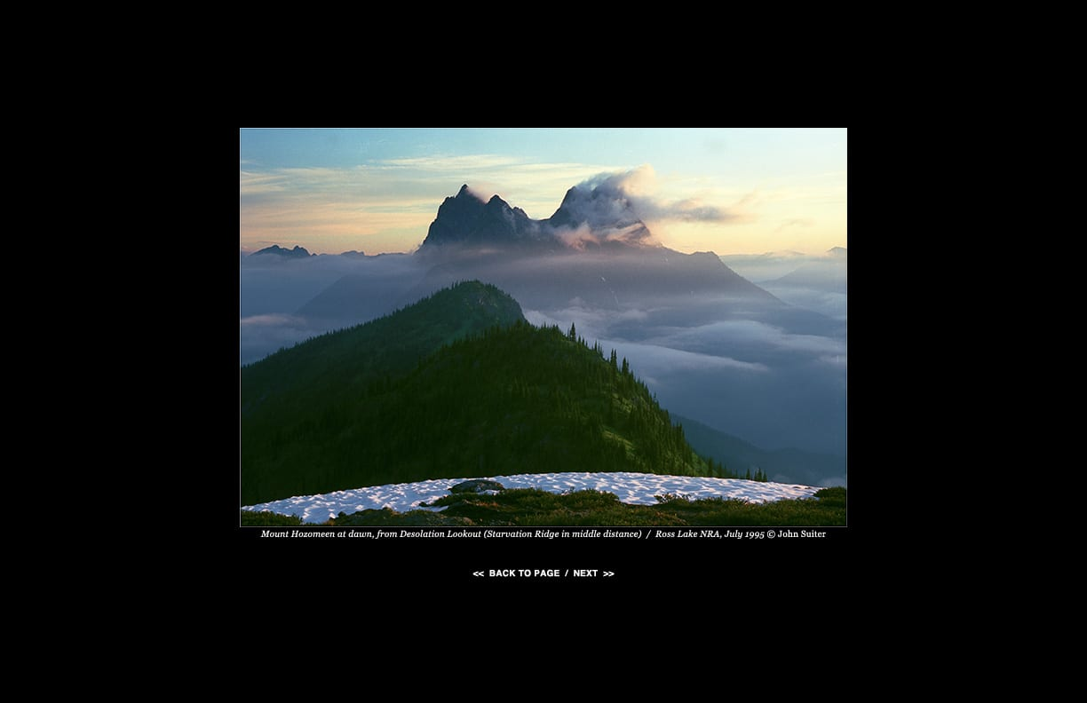 Mount Hozomeen at dawn, from Desolation Lookout (Starvation Ridge in middle distance)  /  Ross Lake NRA, July 1995 © John Suiter